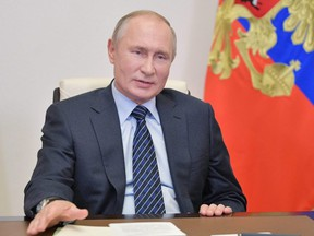 Russia's President Vladimir Putin addresses members of the Russian Union of Industrialists and Entrepreneurs via a video conference call at the Novo-Ogaryovo state residence outside Moscow, Wednesday, Oct. 21, 2020.