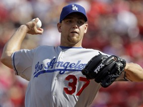 In this Aug. 29, 2009, file photo, Dodgers pitcher Charlie Haeger throws a pitch to a Reds batter during a game in Cincinnati.