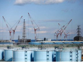 The reactor units No.1 to 4 are seen over storage tanks for radioactive water at Tokyo Electric Power Co's (TEPCO) tsunami-crippled Fukushima Daiichi nuclear power plant in Okuma town, Fukushima prefecture, Japan February 18, 2019.