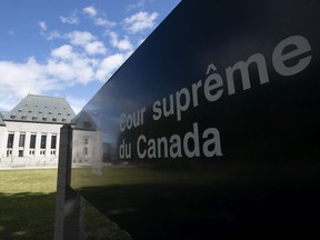Clouds pass by the Supreme Court of Canada in Ottawa, Friday June 12, 2020.
