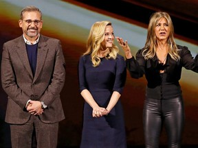 Steve Carell (left), Reese Witherspoon and Jennifer Aniston (right) speak during an Apple special event at the Steve Jobs Theater in Cupertino, Calif., March 25, 2019.