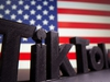 A 3D printed Tik Tok logo is seen in front of U.S. flag in this illustration taken October 6, 2020. Picture taken October 6, 2020. REUTERS/Dado Ruvic/Illustration ORG XMIT: HFS-DAD02