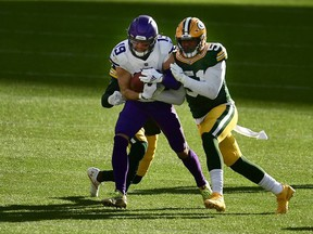 Adam Thielen of the Minnesota Vikings is tackled by Krys Barnes of the Green Bay Packers during the third quarter of the game at Lambeau Field on November 01, 2020 in Green Bay, Wisconsin.