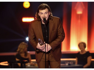 Morgan Wallen accepts and award onstage during the The 54th Annual CMA Awards at Nashville's Music City Center on Wednesday, Nov. 11, 2020 in Nashville, Tennessee.