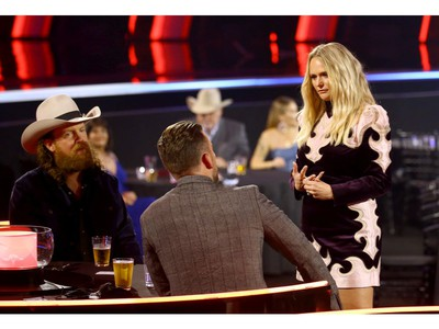 Left to right: John Osborne and T.J. Osborne of Brothers Osborne and Miranda Lambert attend the The 54th Annual CMA Awards at Nashville's Music City Center on Wednesday, Nov. 11, 2020 in Nashville, Tennessee.