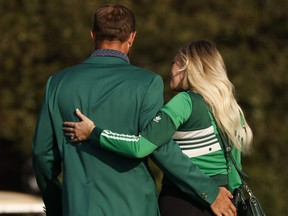 Well before he received the coveted Green Jacket from Tiger Woods, Dustin Johnson received something even more special -- a kiss from Paulina Gretzky.