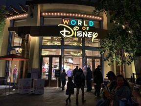 People visit Disneyland, where parts of the park opened for more retail and dining as an extension of the Downtown Disney District in Anaheim, California on November 19, 2020.