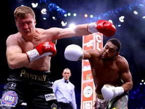 Michael Hunter, right, punches Alexander Povetkin during the of the WBC World Heavyweight Elimnator fight between during the Matchroom Boxing 'Clash on the Dunes' show at the Diriyah Season on Dec. 7, 2019 in Diriyah, Saudi Arabia.
