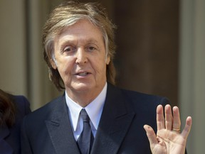 Paul McCartney waves following an Investiture ceremony, where he was made a Companion of Honour at Buckingham Palace on May 4, 2018 in London.