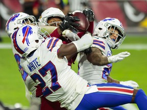 Arizona Cardinals wide receiver DeAndre Hopkins (centre) catches a Hail Mary pass for a touchdown in the closing seconds of the game against the Buffalo Bills at State Farm Stadium.