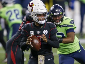 Arizona Cardinals quarterback Kyler Murray (1) drops back to pass against the Seattle Seahawks at Lumen Field.