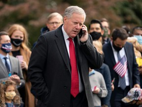 White House Chief of Staff Mark Meadows speaks on his phone as he waits for U.S. President Donald Trump to depart the White House in Washington, D.C., Oct. 30, 2020.