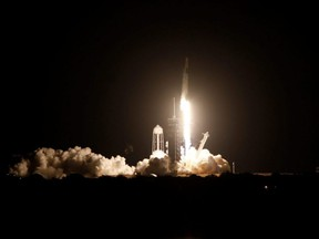 A SpaceX Falcon 9 rocket, with the Crew Dragon capsule, is launched carrying four astronauts on the first operational NASA commercial crew mission at Kennedy Space Center in Cape Canaveral, Fla., Sunday, Nov. 15, 2020.