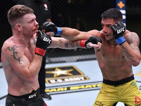 In this handout image provided by UFC, Rafael Dos Anjos, right, punches Paul Felder, left, in a lightweight fight during the UFC Fight Night event at UFC APEX in Las Vegas, Saturday, Nov. 14, 2020.