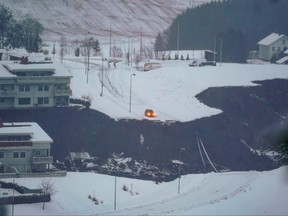 A car has stopped were the road has been swept away by a landslide in the town of Ask, Gjerdrum county, some 40 km northeast of the Norwegian capital Oslo, on Dec. 30, 2020.