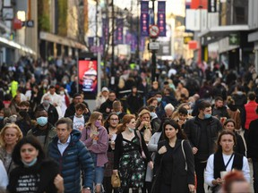 Shoppers and pedestrians fill Northumberland Street in Newcastle-upon-Tyne, in north-east England on Dec. 19, 2020, on the last Saturday before Christmas.