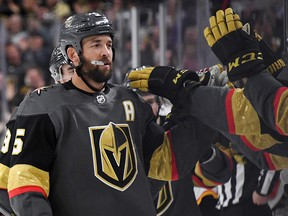 Deryk Engelland of the Vegas Golden Knights celebrates with teammates after scoring against the Calgary Flames at T-Mobile Arena on March 6, 2019 in Las Vegas.