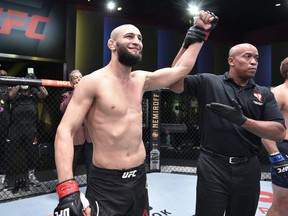 In this handout image provided by UFC, Khamzat Chimaev of Chechnya celebrates after his knockout victory over Gerald Meerschaert in their middleweight bout during the UFC Fight Night event at UFC APEX in Las Vegas, Sept. 19, 2020.