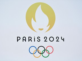 This picture taken on October 21, 2019 shows a logo during a presentation ceremony for Paris 2024 Olympic Games at the Grand Rex cinema in Paris.