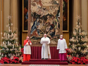 This handout photo taken on December 25, 2020, and released by the Vatican press office, shows Pope Francis delivering his streamed Urbi et Orbi blessing from the Vatican Blessing hall.