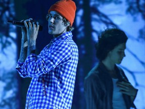 In this handout image courtesy of ABC singers Shawn Mendes, right, and Justin Bieber, left, perform during the 2020 American Music Awards at the Microsoft theatre on Nov. 22, 2020 in Los Angeles.
