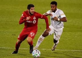 Plans have not been finalized, but Toronto FC midfielder Alejandro Pozuelo and his teammates (left) are hoping to play games at home this season. USA TODAY
