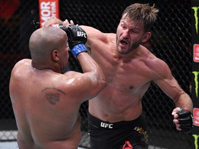 In this handout image provided by UFC, Stipe Miocic (right) punches Daniel Cormier in their heavyweight championship bout during UFC 252 at UFC APEX on August 15, 2020 in Las Vegas.