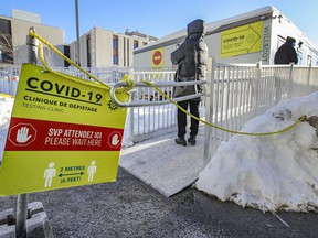 People line up at the COVID-19 testing centre at the Jewish General Hospital in Montreal Feb. 8, 2021.