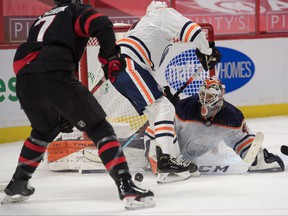 Edmonton Oilers goalie Mike Smith (41) makes a save in front of Ottawa Senators left wing Brady Tkatchuk (7) in the second period at the Canadian Tire Centre on Monday night.