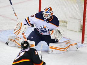 Calgary Flames Mikael Backlund slips one by goalie Mikko Koskinen of the Edmonton Oilers during NHL hockey in Calgary on Saturday February 6, 2021.