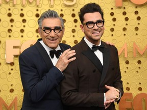 Eugene Levy, left, won Outstanding Lead Actor in a Comedy Series along his son Dan Levy who won Outstanding Writing For A Comedy Series for Schitt's Creek during the 72nd Primetime Emmy Awards ceremony held virtually on Sunday, Sept. 20, 2020.