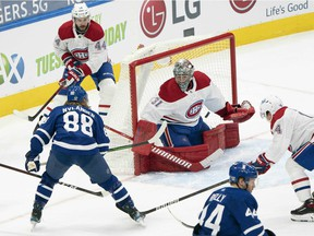 Toronto Maple Leafs centre William Nylander (88) battles for puck in front of Montreal Canadiens goaltender Carey Price during the third period at Scotiabank Arena in Toronto on Saturday, Feb. 13, 2021.