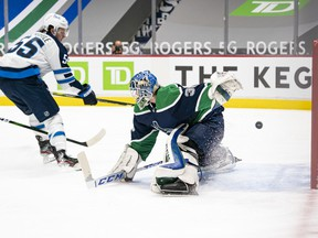 Mark Scheifele of the Winnipeg Jets scores on goalie Thatcher Demko of the Vancouver Canucks for 1-0 lead in the first period at Rogers Arena on Friday, Feb. 19, 2021 in Vancouver.