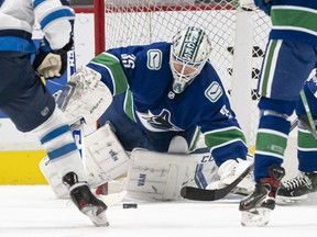 Thatcher Demko of the Canucks makes a save against the Winnipeg Jets during NHL action at Rogers Arena on March 22 in Vancouver.