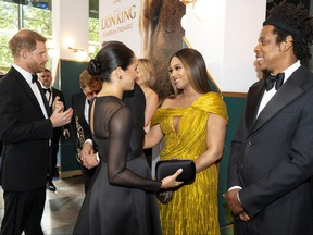 """Prince Harry, Duke of Sussex, left, and Meghan, Duchess of Sussex (second from left) meets cast and crew, including Beyonce Knowles-Carter (centre) Jay-Z as they attend the European premiere of Disney's """"The Lion King"""" at Odeon Luxe Leicester Square on July 14, 2019 in London."""