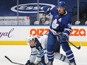 Jets defenceman Dylan DeMelo tries to defend against Leafs sniper Auston Matthews. GETT IMAGES