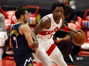 Raptors forward OG Anunoby (right) moves to the basket as Nuggets guard Facundo Campazzo (left) defends during first half NBA action at Amalie Arena in Tampa, Fla., Wednesday, March 24, 2021.