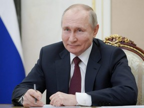 Russian President Vladimir Putin takes part in a meeting with community representatives and residents of Crimea and Sevastopol via a video link in Moscow, Thursday, March 18, 2021.