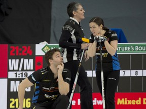 Calgary Ab,March 23, 2021.WinSport Arena at Calgary Olympic Park.Home Hardware Canadian Mixed Double Curling Championship.Kirk Muyres (L), and Laura Walker, (back center) Nancy Martin, during draw 28.Curling Canada/ Michael Burns Photo
