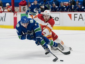 Feb 15, 2021; Vancouver, British Columbia, CAN; Calgary Flames forward Andrew Mangiapane (88) pursues Vancouver Canucks defenseman Quinn Hughes (43) in the first period at Rogers Arena. Mandatory Credit: Bob Frid-USA TODAY Sports ORG XMIT: IMAGN-445158
