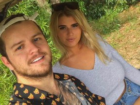 Australian adult model Holly-Daze Coffey poses for a picture with her boyfriend.