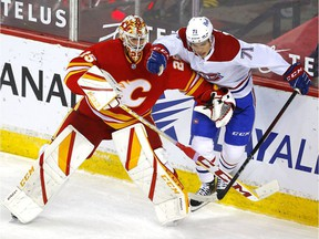 Calgary Flames goalie Jacob Markstrom battles Montreal Canadiens' Jake Evans during third period at the Scotiabank Saddledome in Calgary on April 26, 2021.