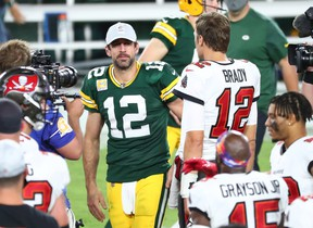 Buccaneers quarterback Tom Brady (right) greets Green Bay Packers quarterback Aaron Rodgers (left) after a NFL game at Raymond James Stadium.