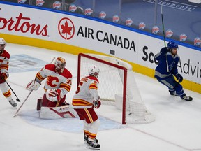 Toronto Maple Leafs' William Nylander celebrates scoring the game-winning goal on Calgary Flames goaltender David Rittich as defenceman Mark Giordano looks on during overtime at Scotiabank Arena on Wednesday, Feb. 24, 2021.