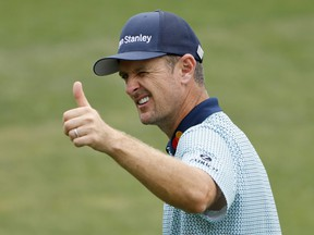 England's Justin Rose acknowledges the crowd on the 18th green after completing his second round at the Masters. Rose has the lead heading into the third round.