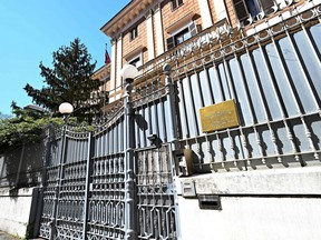 """A picture taken in Rome on March 31, 2021 shows the entrance to the Russian embassy. - Italy expelled two Russian officials on March 31, 2021 after an Italian navy captain was allegedly caught red-handed selling secret documents to a Russian military officer. An Italian naval officer Walter Biot (a frigate captain) was arrested yesterday evening, Tuesday 30 March, by the Carabinieri of the R.O.S. """"Raggruppamento Operativo Special"""" (Special Operations Group), after being detained together with an officer of the Russian armed forces."""