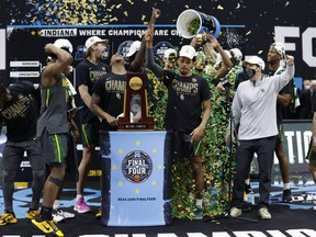 Members of the Baylor Bears celebrate with the trophy after defeating the Gonzaga Bulldogs 86-70 in the championship game of the 2021 NCAA men's basketball tournament at Lucas Oil Stadium in Indianapolis on April 5, 2021.