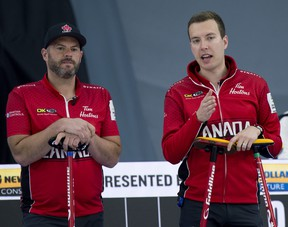 Team Canada skip Brendan Bottcher of Edmonton (right) and third Darren Moulding go over their options during Draw 7 against Team Switzerland.