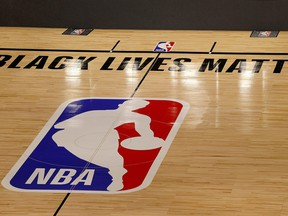 The Black Lives Matter logo is seen on an empty court as all NBA playoff games were postponed today during the 2020 NBA Playoffs at AdventHealth Arena at ESPN Wide World Of Sports Complex on Aug. 27, 2020 in Lake Buena Vista, Fla.