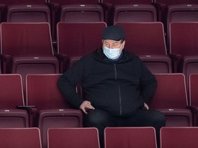 Vancouver Canucks general manager Jim Benning watches the NHL team's training camp in Vancouver, on Jan. 5, 2021.